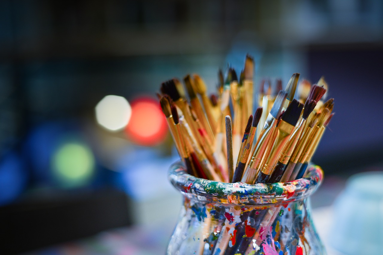 Cup full of paintbrushes.