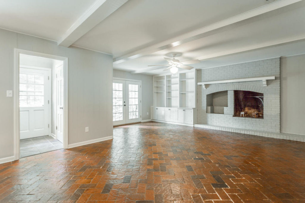 Huge hardwood floor den.