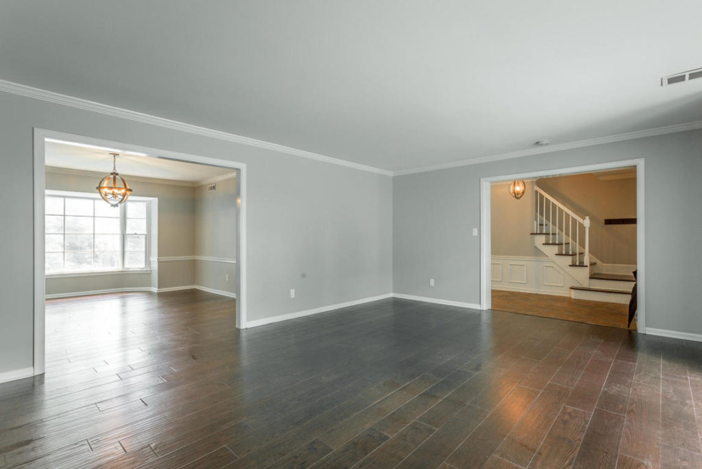 Large interior with stunning hardwood floor.